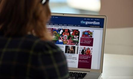 Woman browsing Guardian website