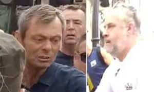 Metropolitan police screengrab of two men they would like to speak to after a police medic was assaulted during a protest by Tommy Robinson supporters.