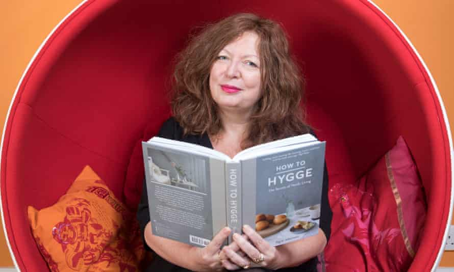 Sitting comfortably: Suzanne Moore at home with her book on hygge.