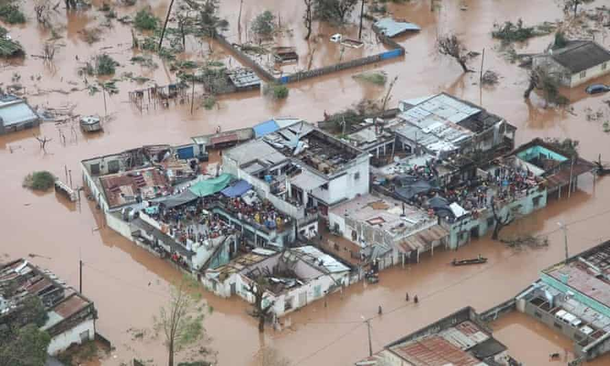 Survivors cling to buildings in the district of Buzi, Mozambique.