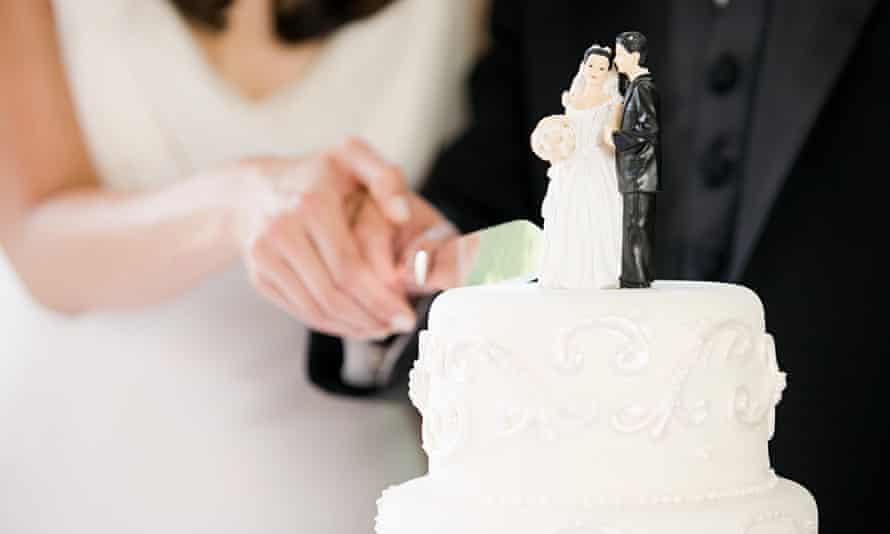 Newlyweds cut a wedding cake