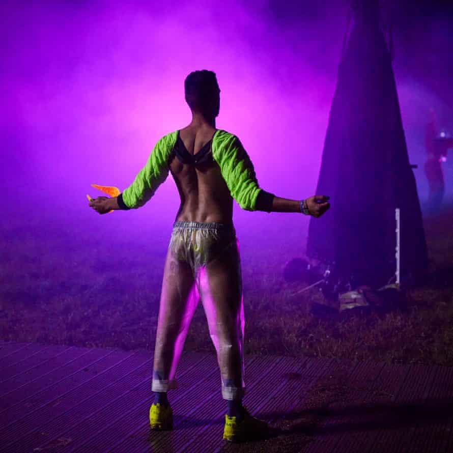 A dancer warms up before Honey Dijon's set.