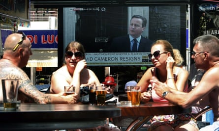 A TV screen at a bar in Benidorm displays David Cameron's announcement of his resignation
