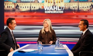 Heinz-Christian Strache, left, head of the Freedom party, presenter Claudia Reiterer and incumbent chancellor Christian Kern, right, on the TV debate in Vienna.