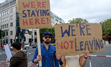 Britons living in Germany hold up signs in protest at Brexit in Berlin last July.