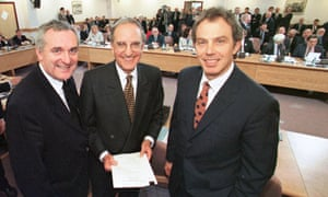 Bertie Ahern, US senator George Mitchell and Tony Blair after signing the Good Friday agreement on 10 April 1998.