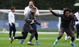 Frank Lampard shares a joke with his Chelsea players at Cobham
