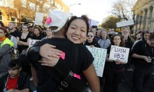 Protesters hug
