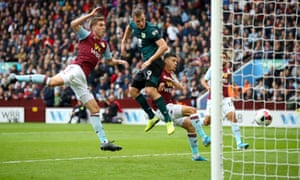 Burnley's Chris Wood heads in the visitors' equaliser.