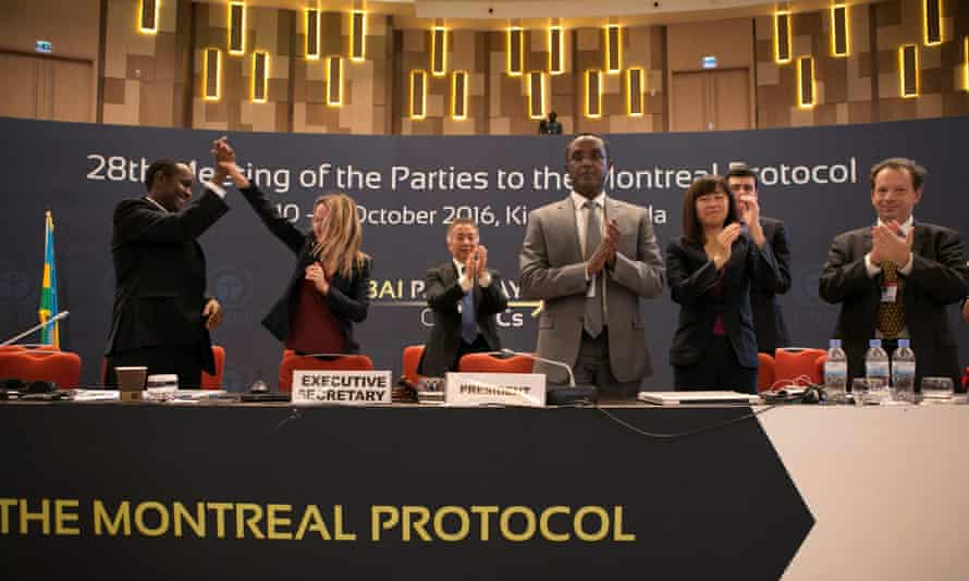 Members of the organising committee in Kigali, Rwanda, celebrate the adoption of an amendment in 2016 to the Montreal protocol on protecting the ozone layer.