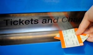 A person buys a train ticket at Finsbury Park station in London.