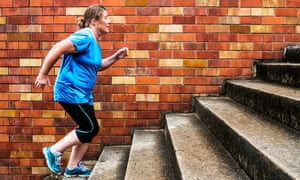A woman running up and down steps for exercise.