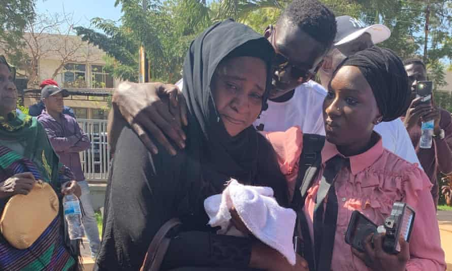 Families mourn in Banjul after the Gambia's justice ministry handed over the remains of former soldiers who were killed in a coup bid against Yahya Jammeh in 2014.