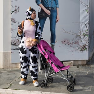 A spectator in a Friesian cow outfit