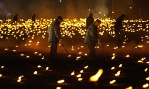 Volunteers and representatives from the armed forces helped to the light the torches.