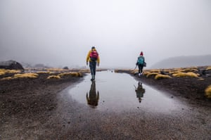 Hikers at the Tongariro Alpine Crossing, North Island, New Zealand, in bad weather