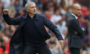 The Manchester United manager, José Mourinho, left, makes a point during a derby against Pep Guardiola's Manchester City
