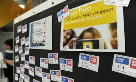Posters promote MeeTwo at Bow school.