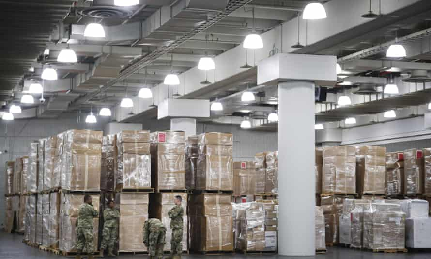 Crates of medical supplies at the Jacob Javits Center, in New York. Authorities say price gougers are stockpiling and selling off essential products.