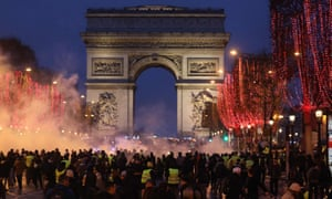 Demonstrators gather near the Arc de Triomphe in an anti-government demonstration.