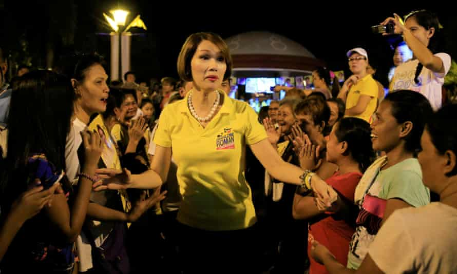 Congressional candidate Geraldine Roman is greeted by her supporters during a  rally in Orani town, Bataan province, Philippines