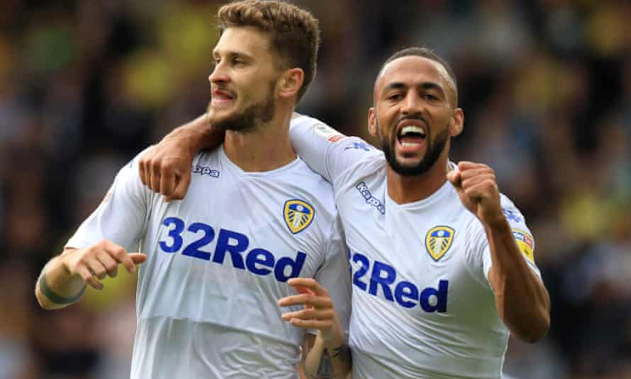 Mateusz Klich, left, celebrates with Kemar Roofe after giving Leeds the lead at Norwich
