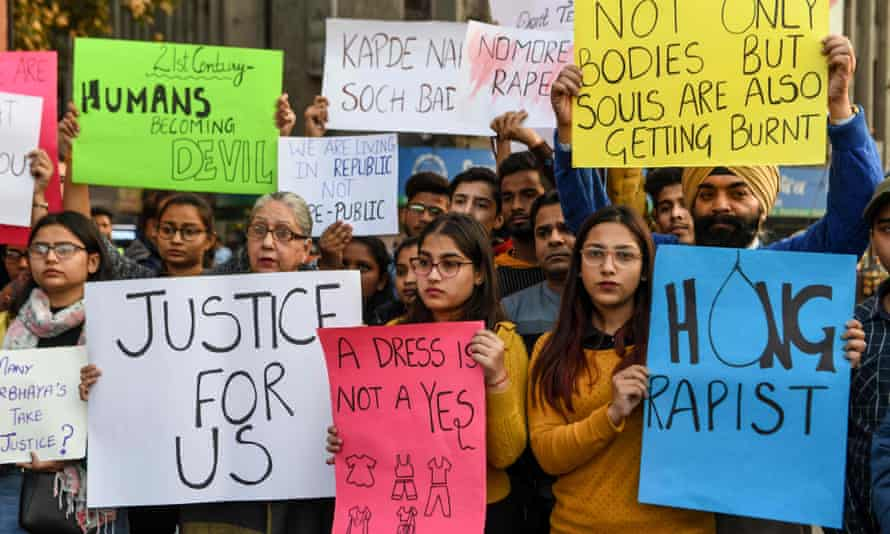 Students and social workers in Amritsar hold placards during a protest seeking for justice for the rape case of a 27-year-old from Hyderabad.