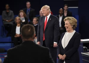 Trump and Clintonlaugh as the final questioner asks them to list positive traits in one another.