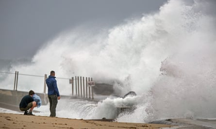 Waves driven by Tropical Storm Isaias crash over the shores of Palm Beach Sunday in Florida.
