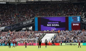 The big screen displays a VAR review message after a goal from Manchester City's Gabriel Jesus is disallowed.