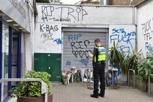 Honoured … flowers and spray-painted tributes at Loughborough Junction, where the three men died.