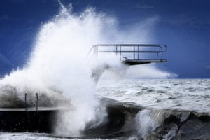 Dramatic scenes near a diving board on the shore of Lake Geneva in Lutry, Switzerland