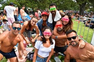 People are seen at Mrs Macquarie's Point in preparation for New Years Eve Fireworks in Sydney