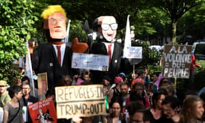 Effigies of Donald Trump and Belgian prime minister Charles Michel during a demonstration in Brussels on Wednesday.