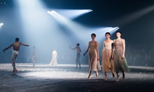 Models and dancers share the runway during the Christian Dior show at Paris fashion week.