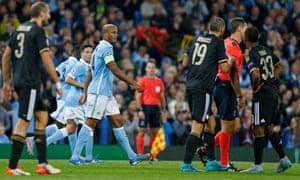 Vincent Kompany looks at referee Damir Skomina as Juventus' Leonardo Bonucci and Patrice Evra remonstrate.