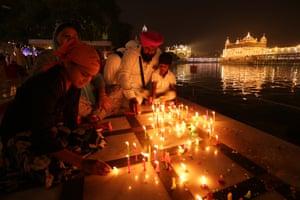Amritsar, India Sikhs light candles at Harmandir Sahib (Golden Temple) for the 485th birth anniversary of the fourth guru Sri Guru Ram Das Ji