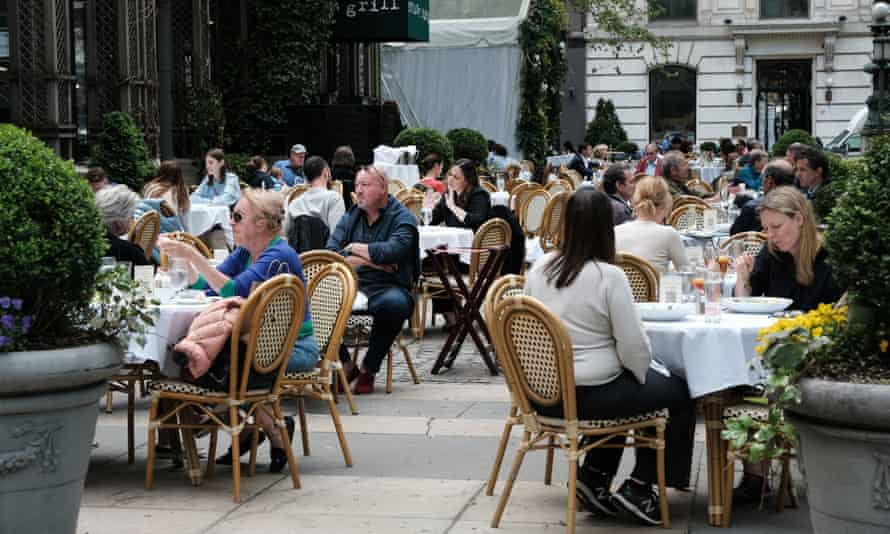 People dine outside in New York City on 4 May.