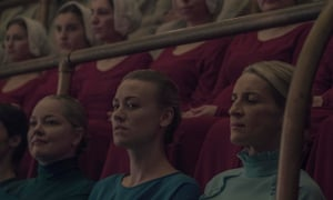 Yvonne Strahovski as Serena Joy (centre) and Ever Carradine as Naomi Putnam (right)