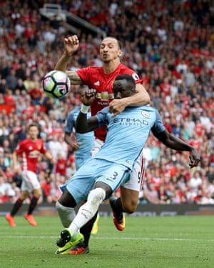 United's Zlatan Ibrahimovic and City's Bacary Sagna tussle.