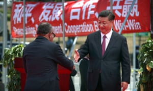 Papua New Guinea's former prime minister Peter O'Neill and China's president Xi Jinping shake hands
