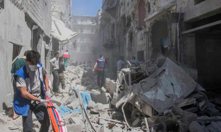 Emergency workers after an airstrike hit a civilian neighbourhood in eastern Aleppo, wounding three.