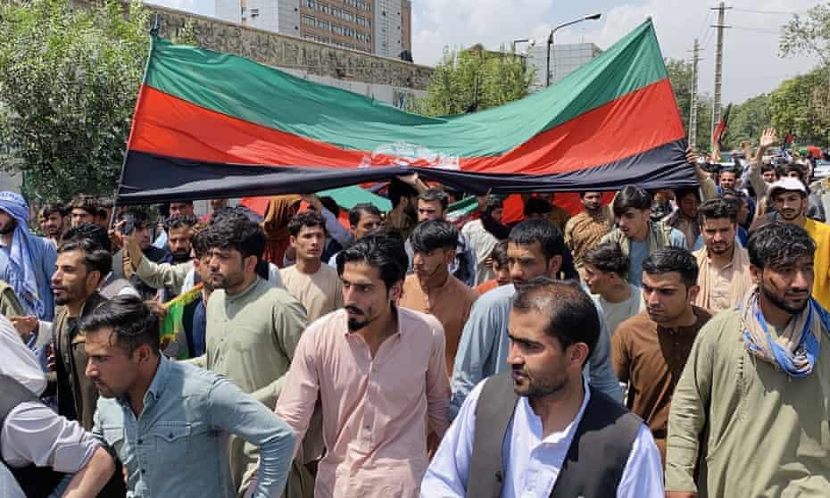 Street full of men with Afghan flag