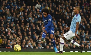 Chelsea's Willian shoots past Manchester City's Fernandinho and wide of the goal.