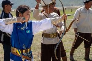 Aliya Kamalova, an archer from Kazakhstan, takes target practice with men