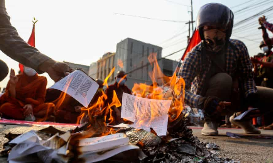 Protesters burn a copy of Myanmar's constitution in Mandalay