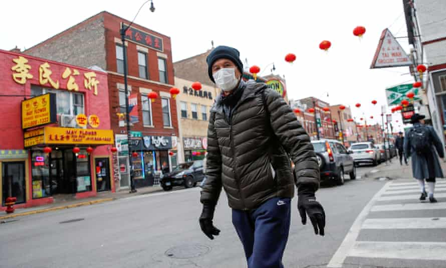 A man wears a masks in Chinatown in Chicago, Illinois.