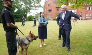 Boris Johnson and Priti Patel during a visit to Surrey police headquarters in Guildford.