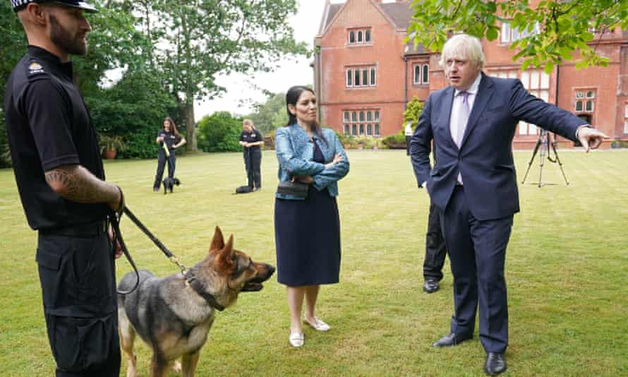 Boris Johnson and home secretary Priti Patel during a visit to Surrey police headquarters in Guildford as part of his 'crime week'.
