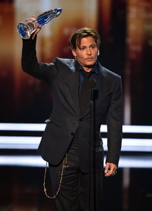 Johnny Depp accepts the Movie Icon award onstage